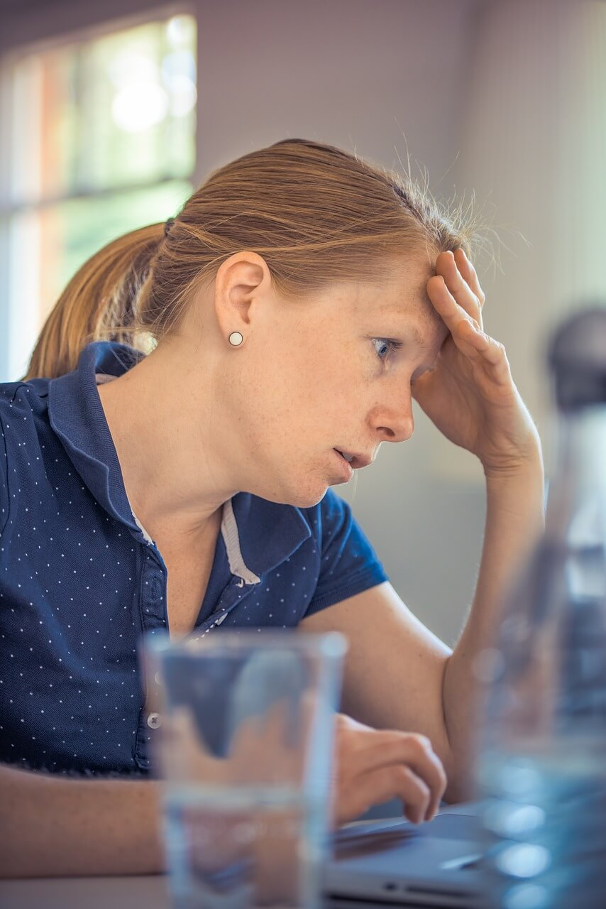 frustrated woman looking at bills