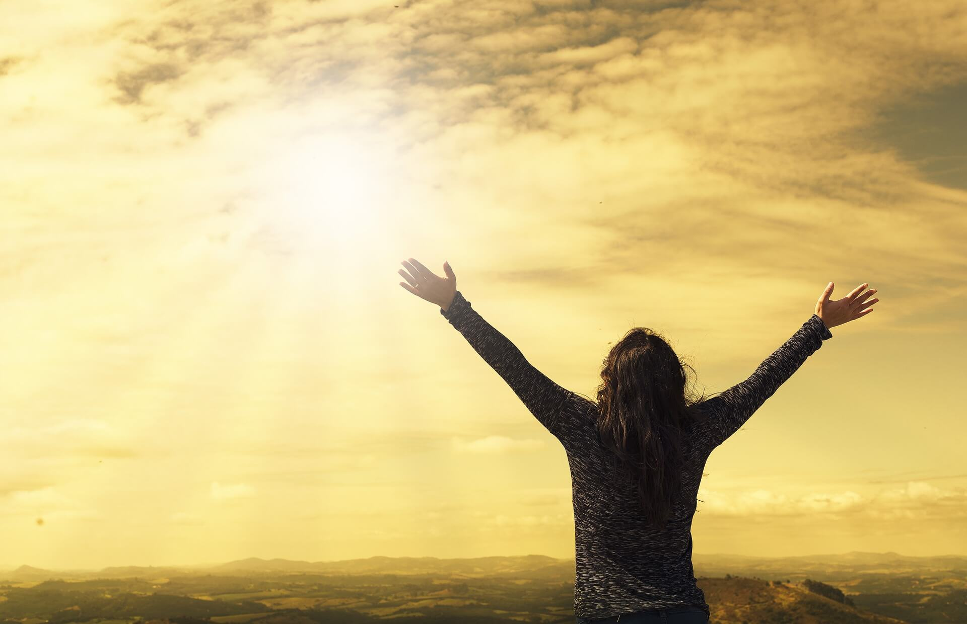 Relieved person raising arms in freedom