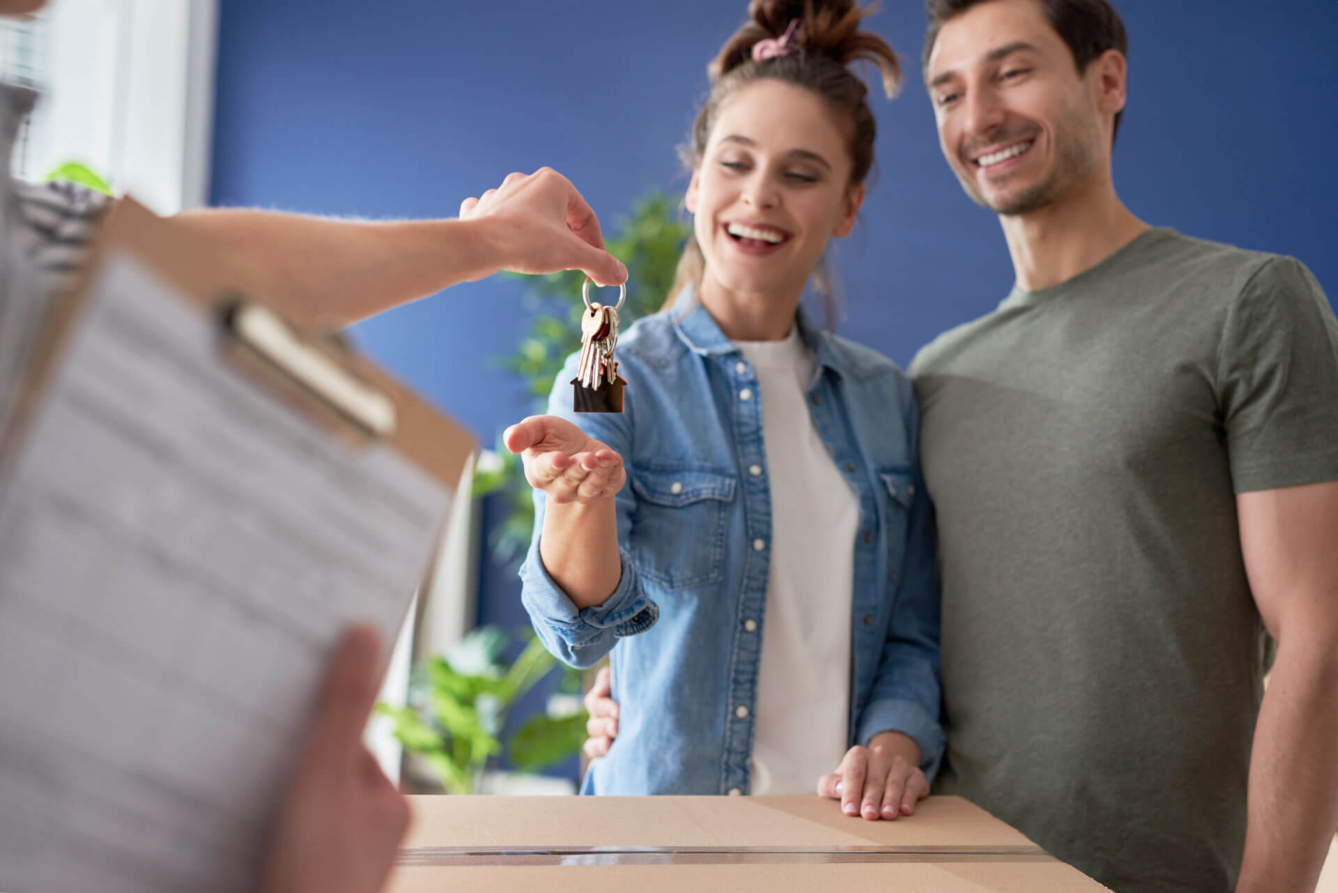 happy couple getting keys to home