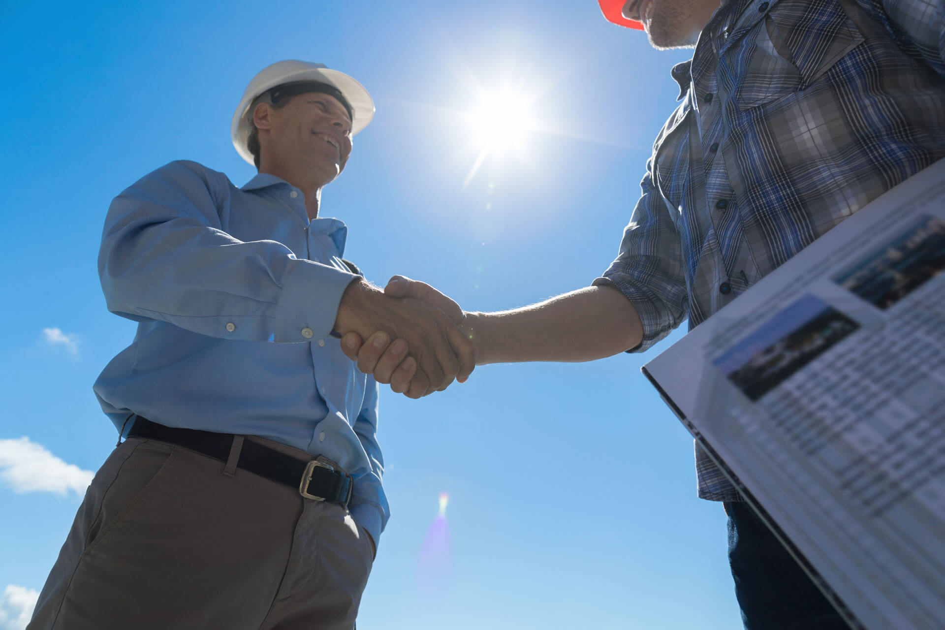 men shaking hands on construction site